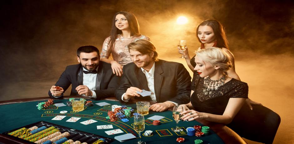 Group of men and women playing poker at the casino