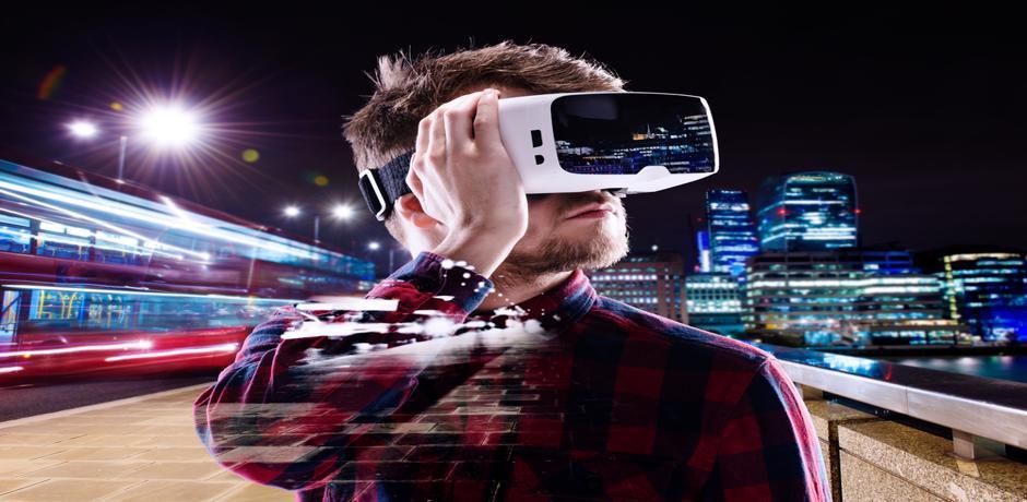 Man wearing virtual reality goggles on a subway platform