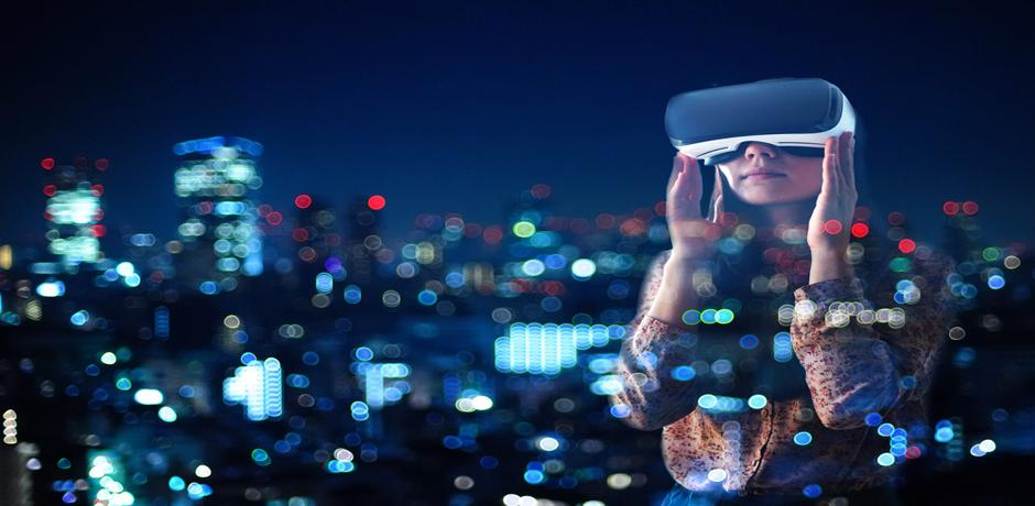 Woman wearing virtual reality goggles, looking at a city skyline at night