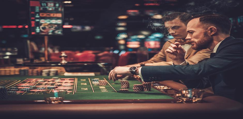 Two man playing poker at the casino