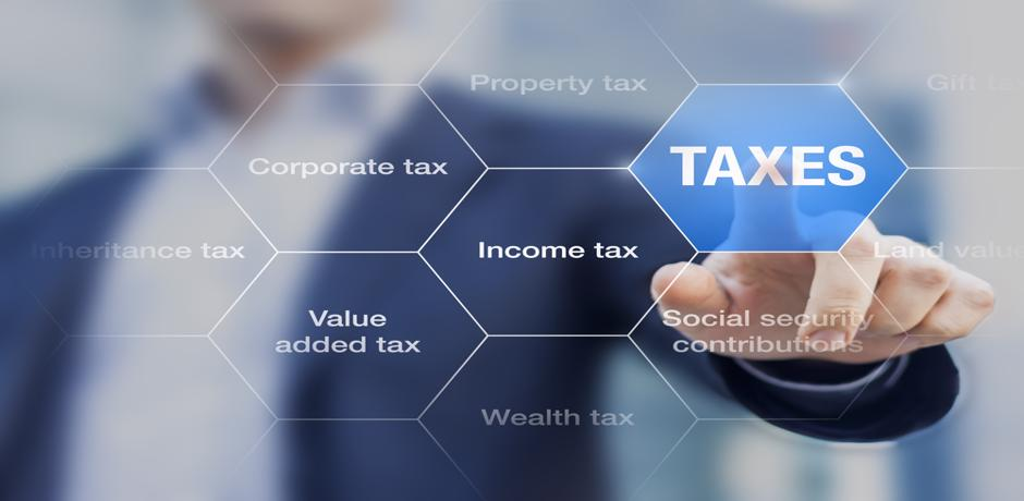 Business man touching a honeycomb digital pattern with the word Taxes