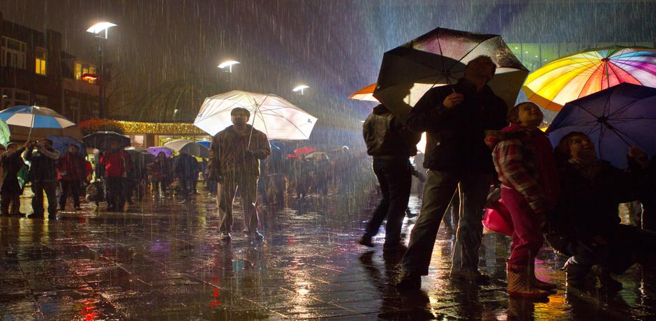 People holding umbrellas in the rain