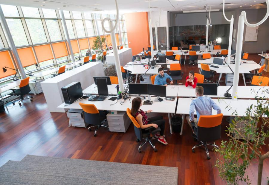 Spacious co-working space with orange chairs