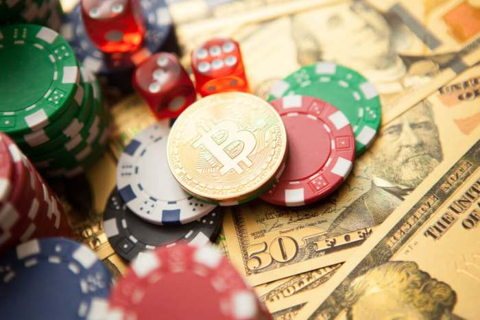 Colorful casino chips, dollars, bitcoins and red dice