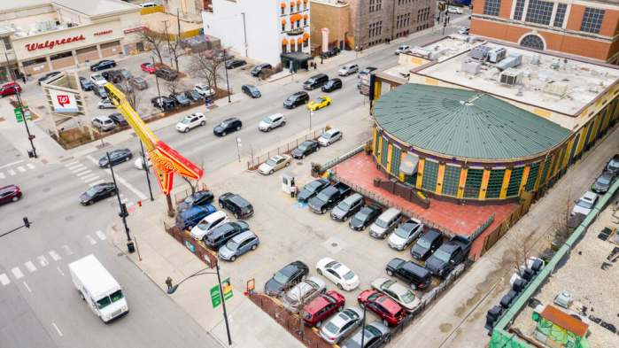 CHICAGO, IL, USA - MARCH 2, 2020: A drone / aerial view of the Hard Rock Cafe in downtown Chicago with cars driving by and a Walgreens store in the background.