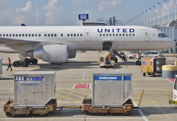 CHICAGO, IL -16 MAY 2015- Baggage containers marked Continental Airlines and United Airlines on the tarmac at Chicago OHare International Airport (ORD). The two companies fully merged in 2012.