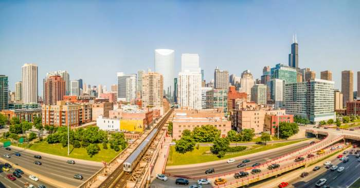 moving to Chicago? Downtown cityscape with elevated train and traffic. Panorama. West Loop, Chicago, USA. Interstate 90 at Lake Street.