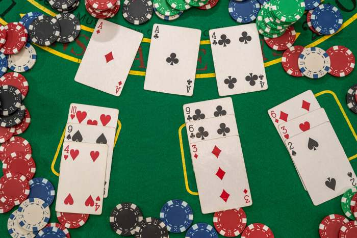 card games popular among chicagoans picture of poker chips with play cards on the green casino table. gambling